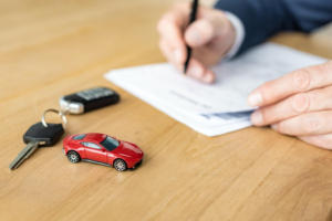 A red toy car and car keys